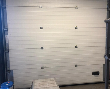 white roller shutter before