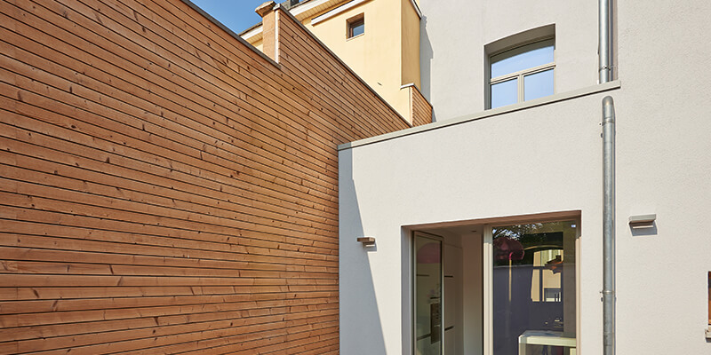 Timber and concrete cladding