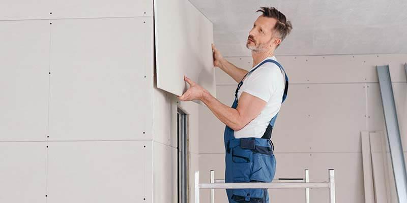 man installing cladding