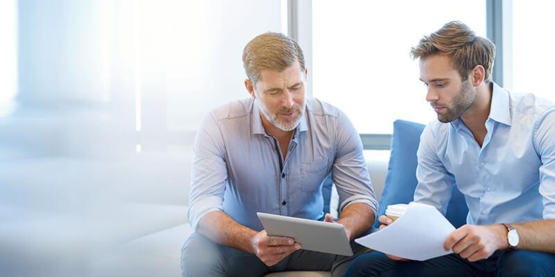 Two men looking through paperwork