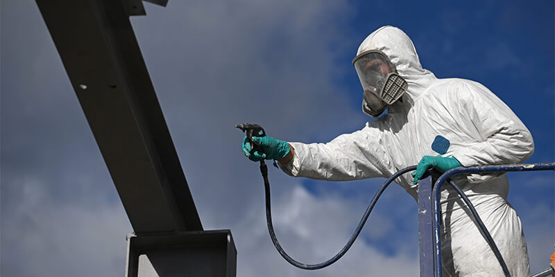 Man On lift Spraying