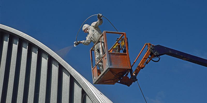 Man On Red Lift Spraying