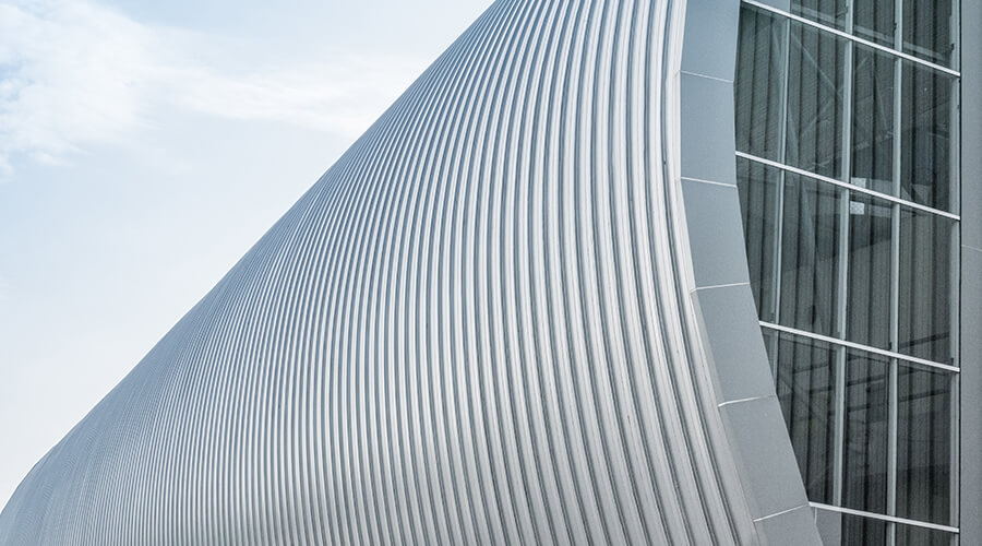 Curved metal cladding