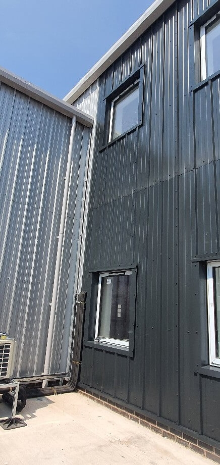 Cladding after spraying