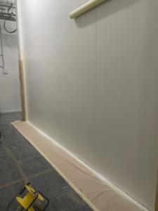 during white panel wall repairs