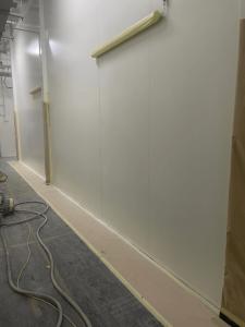 Repairs on white panel walls in progress