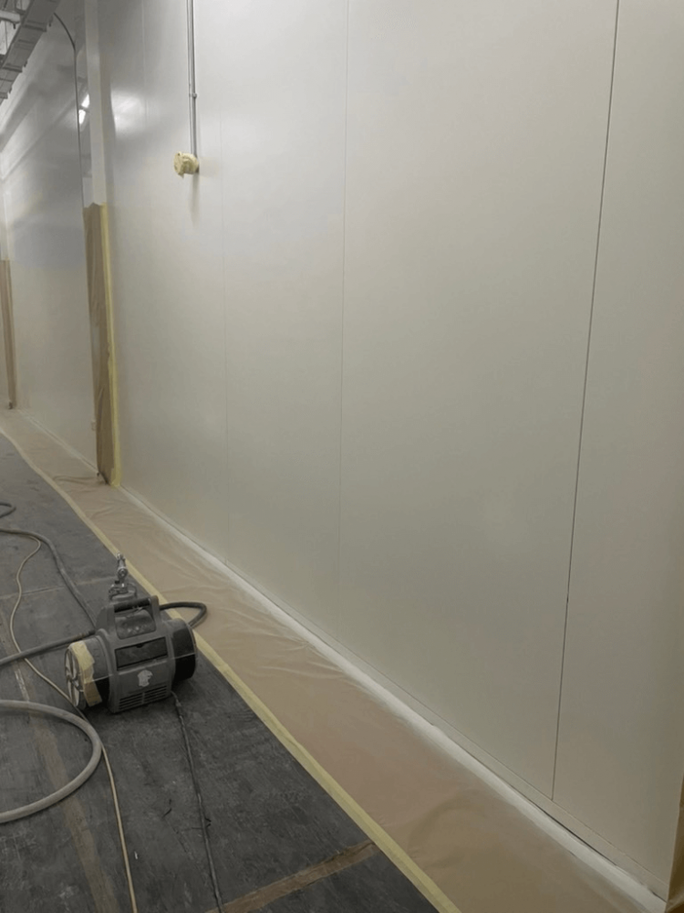 Competing white panel wall project