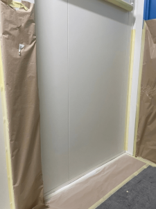 completion of white panel walls