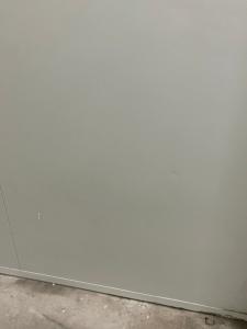 Dents on white panel