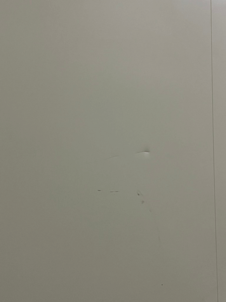 Marks and dents on white panel