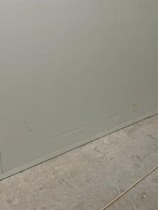 large dent on bottom of white panel